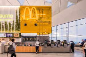 Modern designed McDonald's at Sydney International Airport, with an open kitchen and serving area